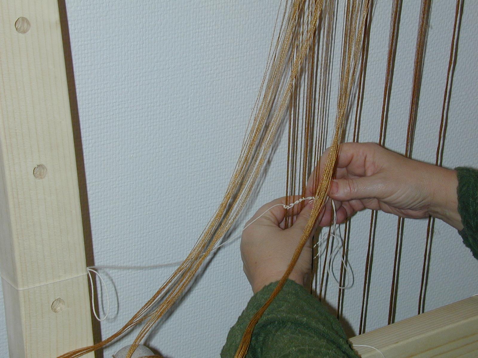 Setting up the loom. Photo S. Spantidaki.