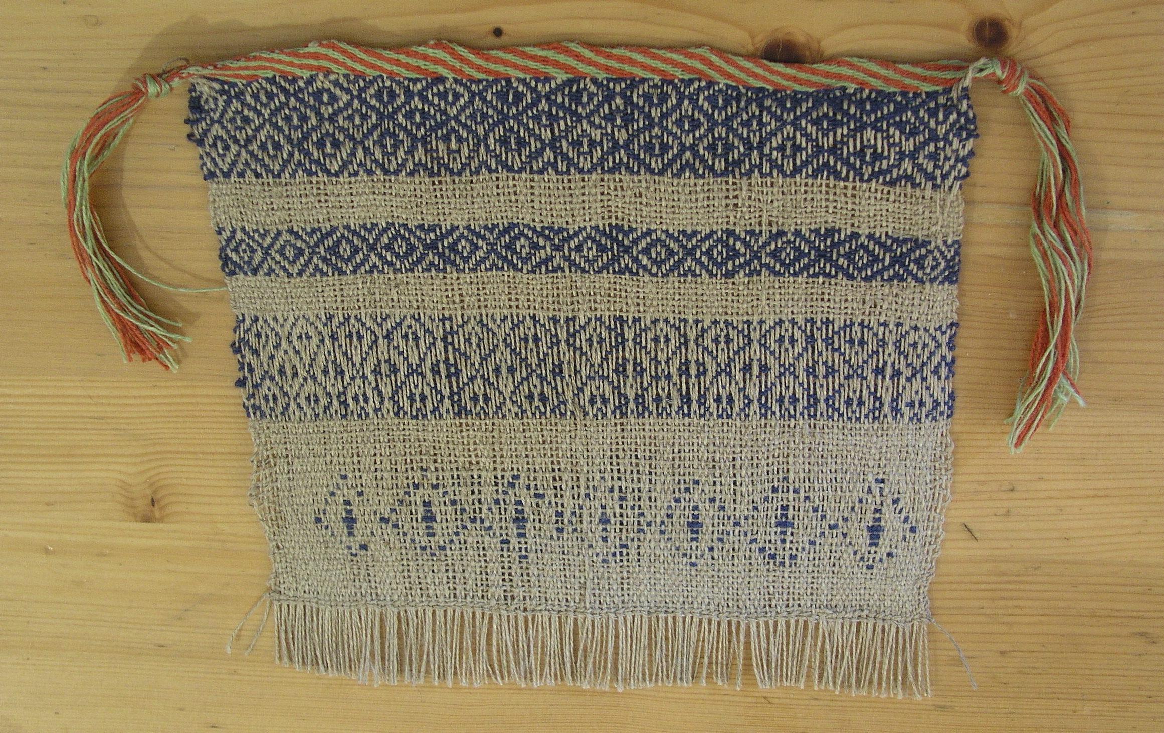 Reconstruction of lozenge patterns on the warp-weighted loom. Photo S. Spantidaki.