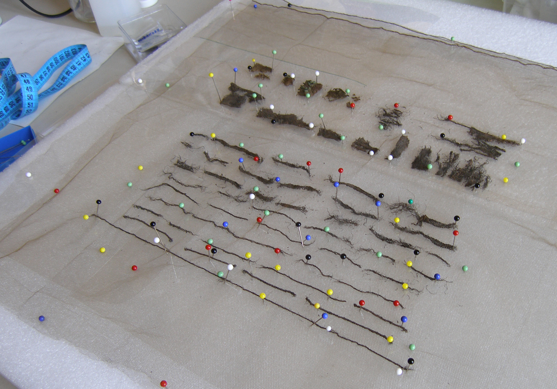 Conservation of archaeological textiles. Photo C. Margariti.