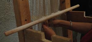 Weaving on the warp-weighted loom. Photo S. Spantidaki.