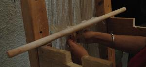 Weaving on the warp-weighted loom. Photo S. Spantidaki.